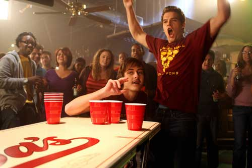 A douche playing beer pong with his awesome douche friends